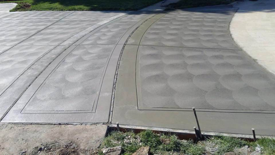 Four concrete slabs in the process of drying at a residential property.
